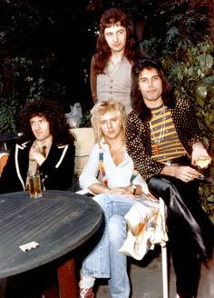 September British rock group 'Queen' (l-r) Brian May (guitarist), Roger Taylor (drums), John Deacon, standing (bass guitar), Freddie Mercury (vocalist). John Deacon, Queen Pictures, Queen Photos, Brian May, I Am A Queen, Save The Queen, Queen Queen, Great Bands, Cool Bands