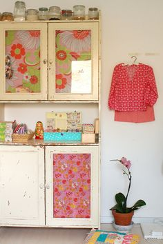 add some beautiful vintage fabric of paper behind the windows for an instant restyle - jasna janekovic