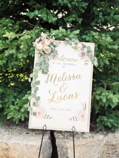 Floral draped calligraphy wedding sign: http://www.stylemepretty.com/canada-weddings/ontario/cambridge-ontario/2015/11/09/elegant-golf-club-wedding-in-ontario/ | Photography: Jesse Rashotte - http://jesserashotte.com/