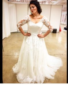 This pretty plus size wedding dress has lovely sheer lace sleeves. The modified a-line skirt also features lace detail. You can have custom plus size wedding dresses like this created for you with any modification you need by our design firm. Get pricing on wedding gowns (as well as replicas of couture gowns too) when you visit our website