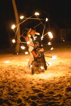 Add a more sparks and glow to your beach wedding by having fire dancers perform during your reception!  Photo credit: Photography by Elvira