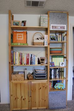 Ivar shelving with fabric stapled to hide the side.