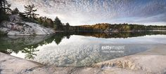 View top-quality stock photos of Rocks And Autumn Trees On A Shore Of Lake George Beautiful Fall Nature Panoramic Scenery Killarney Provincial Park Ontario Canada. Find premium, high-resolution stock photography at Getty Images. Autumn Nature, Autumn Trees, Lake George, Wilderness, Scenery, Stock Photos, River, Park, Photography