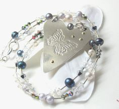 Float - sterling silver heart with butterfly kimmeline.epla.no