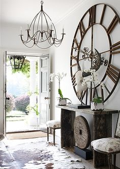 Decor Ideas For An Entryway Using A Large Wall Clock That Is Metal. Decorating  Ideas For Clocks In Art Gallery Walls And