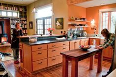 Peninsula in reclaimed fir. Fir cabinets and floor. Floating shelves. Tour: Ginnie and Janie's Warm, Colorful Kitchen.