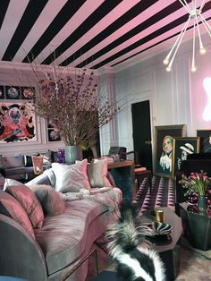 "Designer @abuzzetta painted the walls of his ""fun, crazy parlor room"" light grey, but you'd never know it from this photo, right? Antonino's custom neon sculpture cast a sexy pink glow over all the surfaces, tinting everything from the walls to the furniture. Thinking about trying a trendy shade in your home but don't want to make a huge commitment? Start with a light neutral on the walls, then pop in colored bulbs. Antonino Buzzetta Holiday House NYC 2015"
