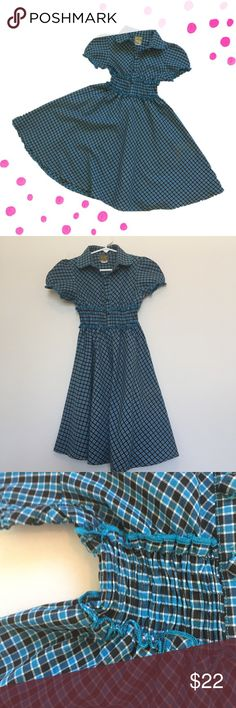 Girls' Circle Style Dress Your little girl will twirl all day long in this dress!  It has a gathered elastic waist, four buttons on chest area, and a wonderful circle skirt style bottom.  Puffy sleeves gives this dress a classic look.  Adorable!  My daughter is sad to sell it, but she just grew about of too quickly!  Excellent condition! Maria Elena Dresses Casual