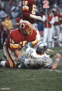 Dave Butz #65 of the Washington Redskins hits Roger Staubach #12 of the Dallas Cowboys during an NFL football game November 18, 1979 at RFK Stadium in Washington, D.C. Description from gettyimages.com. I searched for this on bing.com/images