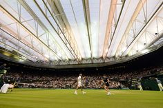 Thursday 26 June 2014 / Wimbledon 2014 / Roger Federer on Centre Court with the roof closed - Javier Garcia/AELTC