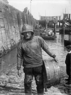 """""""The fisherman's smock is a classic example of functional, utilitarian clothing. This Folkestone fisherman is wearing the traditional pocketless version- cut from sailcloth, a strong and sturdy extra layer that kept the wearer warm and dry, protected his woolen jumper, and was comfortable and easy to work in."""""""
