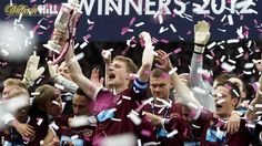 Hearts players celebrate after lifting the Scottish Cup
