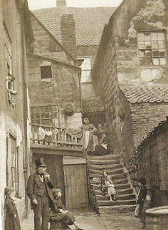 """England"", looks like a very poor neighborhood, and very old - look how worn the steps are"