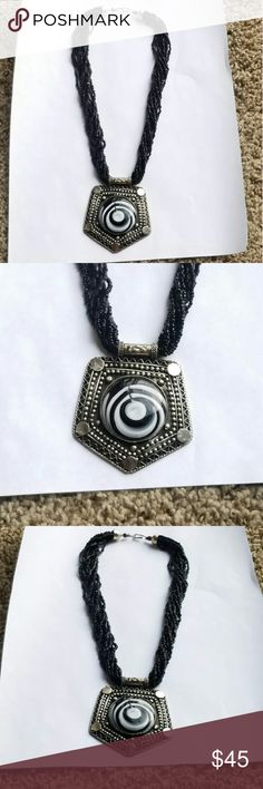 Stunning Silver w/ Black Beads statement necklace Gorgeous and uniqur black and white enamel embedded into a silver handmade pendant strung onto a multi-strand black beaded necklace   Found this stunning piece abroad, in India I believe Jewelry Necklaces