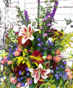 Bright Funeral Flower Arrangement.  http://www.winfieldflorist.com/product.cfm/iteID/2275