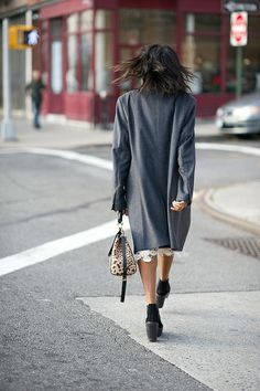 love that little bit of lace detail under that grey coat. NYC.