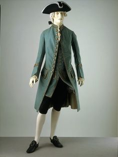 """1760 British Coat at the Victoria and Albert Museum, London - From the curators' comments: """"By the 1760s men's formal day wear was becoming more subdued in colour and decoration. This suit of wool instead of silk, with only a narrow trimming of braid, is an example of the new restraint evident in men's clothing. By 1760 the fronts of the coat were starting to curve back. The side pleats are less voluminous than they were earlier in the century."""""""