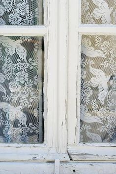 Lace in the window of an old farmhouse. Reminds me of my Grandmother.