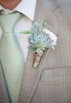 The groom's boutonniere will be a teal succulent paired with ivory spray roses and seeded eucalyptus wrapped in teal ribbon with the stems showing