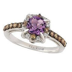 Indulge in the elegant beauty of Chocolate by Petite Le Vian. With a cushion cut Hard Candy Amethyst at its centre, this stunning ring is crafted from sumptuous 14ct Vanilla Gold and finished with a halo and shoulder set design of deliciously dazzling Chocolate and Vanilla Diamonds for breathtaking beauty and unique, glamorous style.
