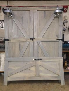 Barn Door HeadBoard and FootBoard - my husband makes these. They can be stained any color with different hardware and lights - custom made!