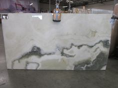 White Onyx slabs are an exceptionally unique material that is often chosen for its beauty to build fireplace surrounds, baths, bars and accent walls.
