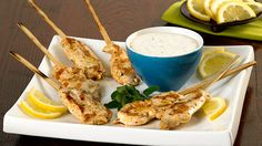 This Greek-style appetizer is made with the boneless chicken breast fillets sold in our meat department. Serve with tzatziki sauce for dipping. Chicken Breast Fillet, Boneless Chicken Breast, Greek Style Chicken, Canvas And Cocktails, Lamb Skewers, Greek Style Yogurt, Tzatziki Sauce, Chicken Skewers, Dinner Is Served