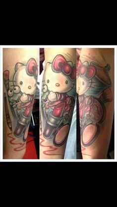Hello kitty tattoo by Emily Schmitt