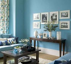 Blue living room, white frames, wood accents