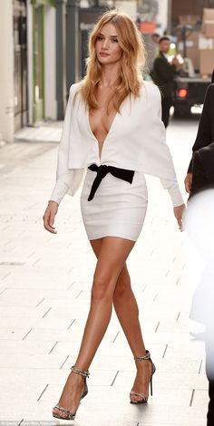 Rosie Huntington-Whiteley looked stunning in a sexy white dress at the Coca-Cola Life launch on Friday morning in London