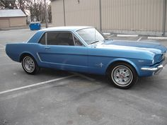 mustang '64....just like the one I owned in 1968, except it was navy blue. I was in the 10th grade. AWESOME car
