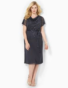 Beautiful dress creates the illusion of a cowlneck top and skirt combo. Flattering, all-in-one piece is stitched underneath the draping, shimmering sequin top to connect it to the chiffon skirt below. Short flutter sleeves. Removable ties at the waist. Fully lined. Catherines dresses are expertly designed for the plus size woman. catherines.com