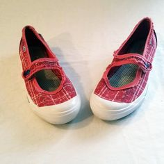Keds Mary Jane Inspired Flats These Keds athletic-inspired mary jane is crafted for comfort. Soft canvas fabric.  The bright pink floral accented pattern makes it a cute sneaker alternative for errands, travel, or any day you will be on your feet  Canvas floral print Mary jane sneakers Button close over strap Plaid and floral print. MSRP $45.00 #160338 Keds Shoes Flats & Loafers