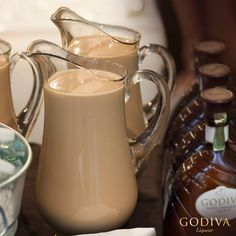 GODIVA Chocolate Martini Pitchers  Serves 7 1. Combine 7.5 oz. of chilled GODIVA Milk Chocolate Liqueur and 7.5 oz. chilled CIROC Vodka into pitcher and stir.  2. Set out chilled Martini glasses and a bowl of GODIVA truffles and let the girls indulge.