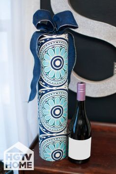 HGTV's @Hollie Baker. Camille Smith dressed up this shipping tube with HGTV HOME Fabric to create a great gift wrap for anything from a piece of art to a bottle of wine. #12DaysOfHGTVHOME How-To: http://www.hgtv.com/handmade/easy-fabric-gift-wrap/index.html