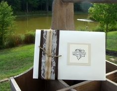 "Save the date envelopes with handsewn envelope ""garter"""