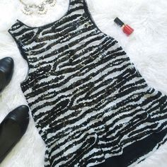 """Zebra Sequin Tank Sleeveless, lined, peplum, all over zebra pattern in black and white sequins top with concealed back zipper. Dress it up or down and go out on the town!   Approx. length from shoulder to bottom of hem: 24"""" Chest measurement laying flat: 17""""                       Open to all reasonable offers!                              Ask about discounted bundles.                                                      No trades. BB Dakota Tops Tank Tops"""