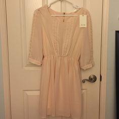 Light pink casual/semi formal day dress Cute and simple light pink dress. Cute details and fits nicely. Dresses Long Sleeve