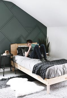 A modern teen boy bedroom, full of inspiration and ideas for making over a teen boy's bedroom. The room is simple, with a modern, rustic touch.