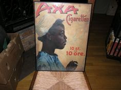 Reklamskylt från Cigarettfabriken Orient, Stockholm    AXA Cigaretten 10 st 10 öre.