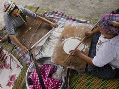 Protecting A Turkish Culinary Treasure | Two women sit facing each other on a rug as they chat and roll out rounds of bread dough using thin batons of wood. Beside them, another woman stretches a dough circle further as she holds it over a wood-burning, dome-shaped griddle, or sa�, turning it around and around until it�s firm, crisp and golden. [�]