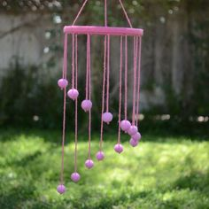 Now that a boy is about to share my daughter's room with her I can't use this pink mobile I made her anymore! I think my son deserves me to 'man up' the uber feminine room a little  So this weekend I'm crafting them a new mobile and new dream catcher to make the room a little more gender neutral! I'm thinking grays blues and white for the new mobile and maybe a red dream catcher!