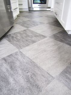harlequin tile floors | (harlequin) of grey on grey tiles is used on the kitchen floor ...