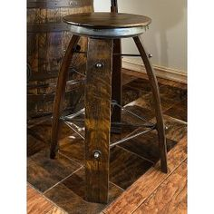 Recycled staves from a wine barrel comprise its four legs and the swivel top is made from rough sawn pine with a wine barrel ring on the base | Rustic stools