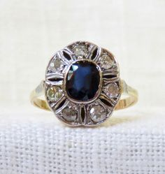 1920s Art Deco 18k Gold Blue Sapphire and Diamond Halo Engagement Ring 1.35 Carats by MagpieVintageJewelry on Etsy