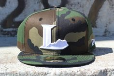 Camo Lexington Legends hat from Oneness
