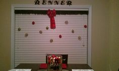 Simple, cheap holiday decor. Tension rod, garland, fishing line, and ornaments. Simple!