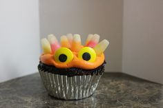 Butter cream frosting, Starburst candy corn hair, Wilton candy eyes.