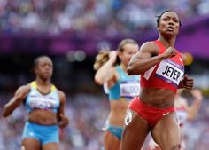 United States' Carmelita Jeter, right, crosses the finish line in a women's 100-meter heat during the athletics in the Olympic Stadium at the 2012 Summer Olympics, London, Friday, Aug. 3, 2012. (Anja Niedringhaus / AP) - http://www.PaulFDavis.com/success-speaker (info@PaulFDavis.com)
