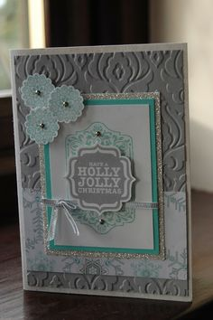 """Holly Jolly Christmas -  Baked Brown Sugar, Crisp Cantaloupe, Pistachio Pudding, Basic Grey, snowflake images from Around Aray,punched out with the 7/8"""" Scallop Circle Punch, Holly Jolly -Tags 4 You has a matching punch -Label Bracket, Beautifully Baroque embossing folder, 1/8"""" Silver Ribbon"""